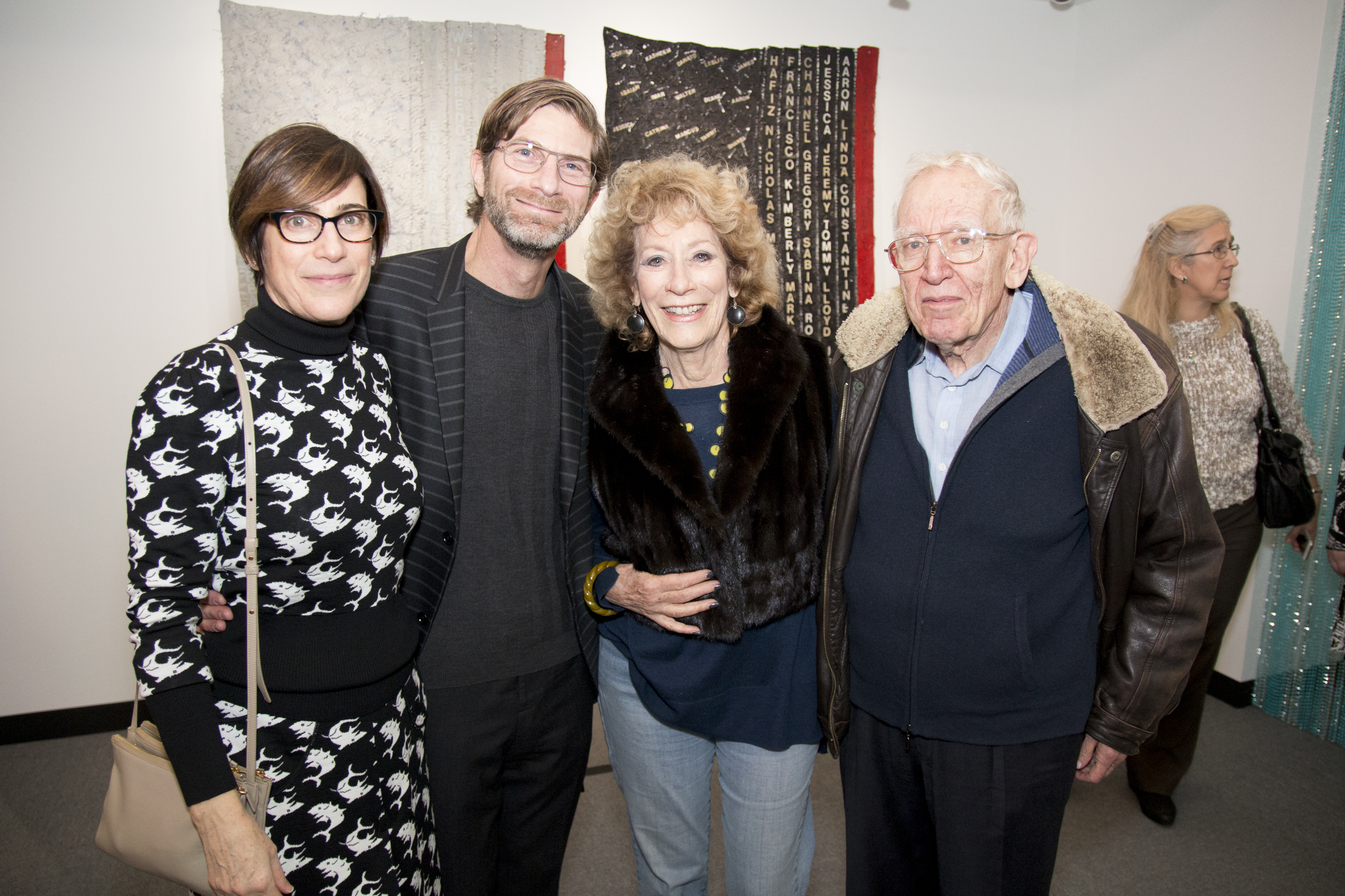 Madeleine Grynsztejn, Pritzker Director of the Museum of Contemporary Art Chicago, Tom Shapiro, Bette Cerf Hill, Bruce Sagan, and Joan Barry (in background) in front of Howardena Pindell's Separate but Equal Genocide/AIDS. Image by Erik Kommer December 2, 2016
